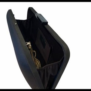 Satiny black purse by Zara